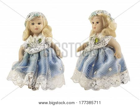 Porcelain doll in blue dress. Isolated porcelain doll with curly blond hair in blue dress front and angle view photo.