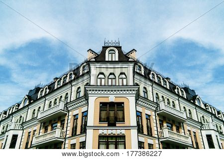 Symmetric building with sky on the background