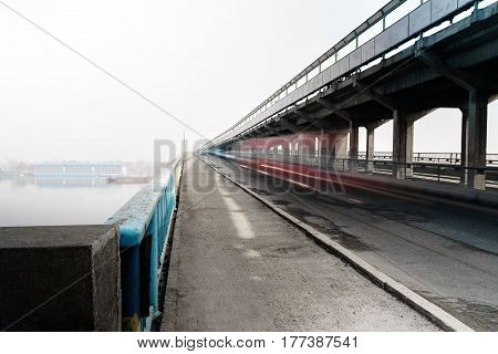 Cars on the bridge above the river