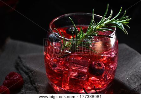 Cocktail Rosemary Accompanied By Raspberries