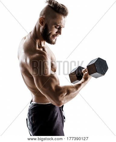Powerful bodybuilder guy doing exercises with dumbbells at biceps. Photo of sporty male with naked torso on white background. Strength and motivation