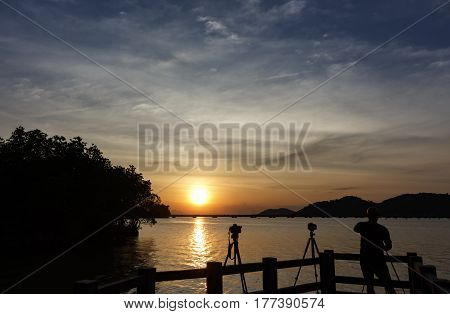 silhouette photographer Nature and sunset at songkhla lake thailand