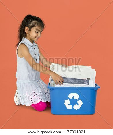 Little Girl with Recyclable Paper Environmentally
