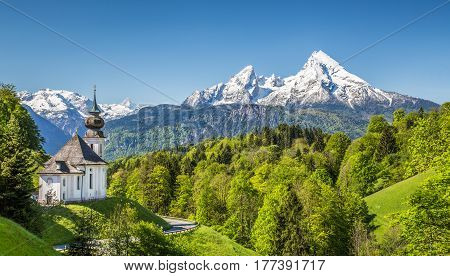 Beautiful mountain landscape in the Bavarian Alps with pilgrimage church of Maria Gern and Watzmann massif in the background Nationalpark Berchtesgadener Land Bavaria Germany