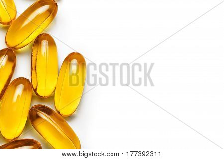 Capsules Omega 3 on white background. Copy space for your text. Top view close up high resolution product. Health care concept