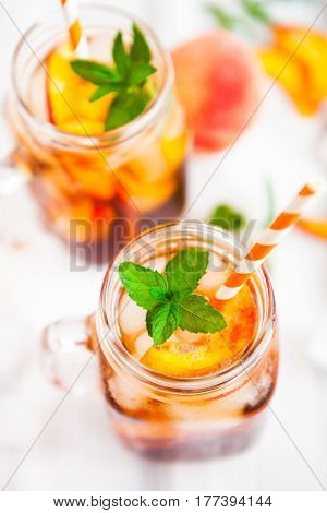 Homemade Lemonade With Ripe  Peaches And Fresh Mint. Fresh Peach Ice Tea On White Wood Table. Copy S