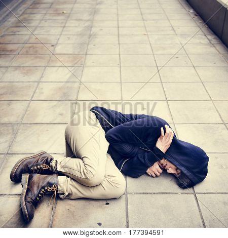 Young man homeless sleep on the street