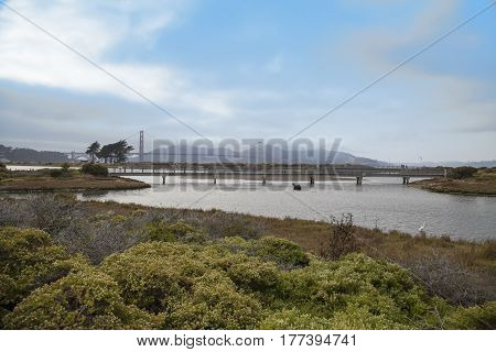 A landscape with the Golden Gate Bridge in San Francisco in the distance