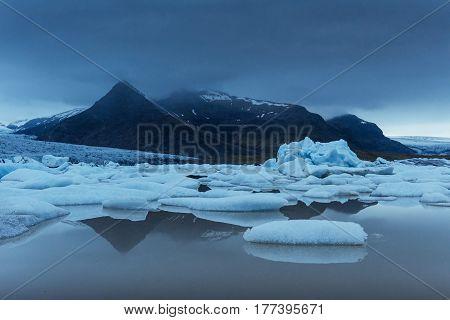 Jokulsarlon Glacier Lagoon, Fantastic Sunset On The Black Beach, Iceland