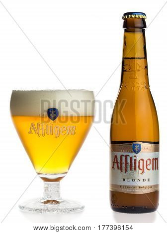 GRONINGEN, NETHERLANDS - MARCH 20, 2017: Bottle and glass of Belgian Affligem Blonde beer isolated on a white background