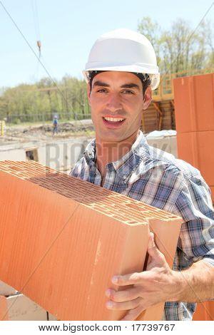 Portrait of smiling bricklayer