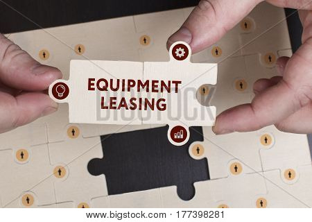 Business, Technology, Internet And Network Concept. Young Businessman Shows The Word: Equipment Leas