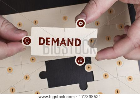 Business, Technology, Internet And Network Concept. Young Businessman Shows The Word: Demand