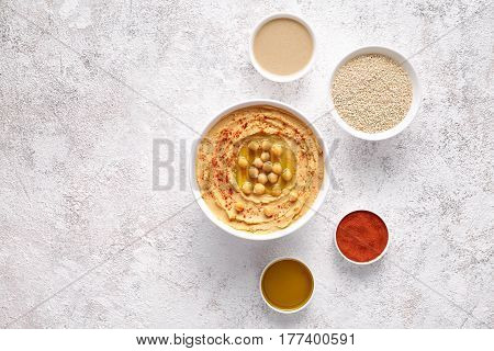 Hummus traditional middle eastern homemade appetizer healthy vegan paste snack flat lay with natural ingridients, tahini, paprika, olive oil, pitta. Healthy vegetarian diet nutrition protein food