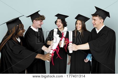 Diverse Group Of Students Holding Diploma