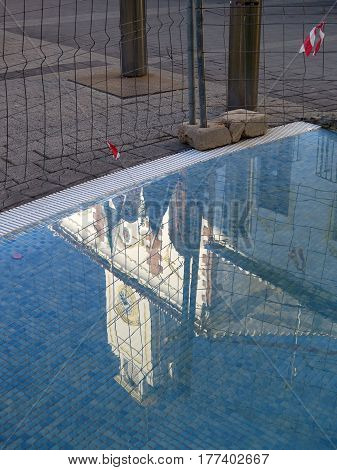 Town Hall Reflected In Fountain