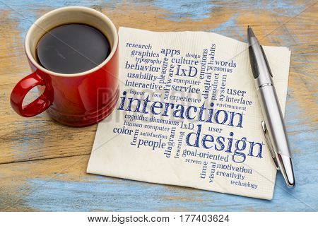 interaction design word cloud - handwriting on a napkin with a cup of coffee