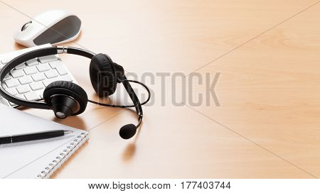 Office desk with headset and pc. Call center support table. Veiw with copy space