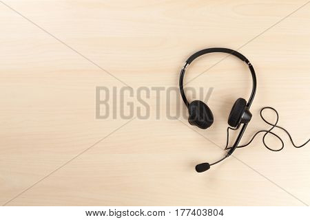 Office desk with headset. Call center support table. Top veiw with copy space