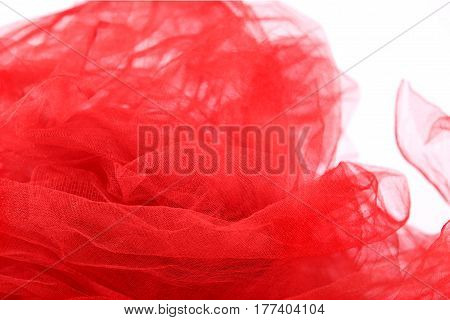Red tulle fabric background. Abstract transparent material curve wave.