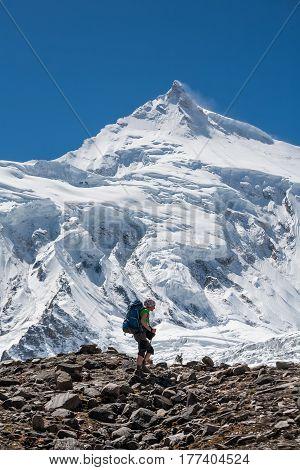 Trekker In Front Of Manaslu Glacier On Manaslu Circuit Trek In Nepal