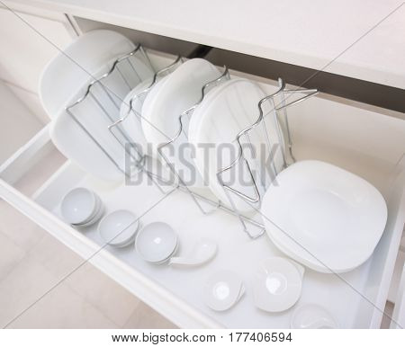 Plates in a kitchen drawer