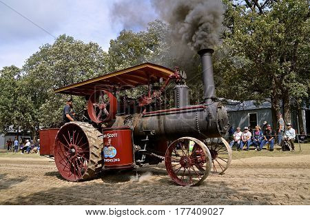 ROLLAG, MINNESOTA, Sept 1. 2016: A restored Gaar Scott steam engine billowing black smoke is being driven in the parade  at the annual WCSTR farm show in Rollag held each Labor Day weekend where 1000's attend.