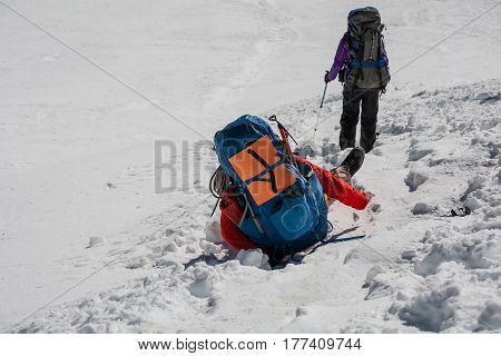 Trekker stuck in the hole in snow while crossing Cho La pass in Everest region Nepal