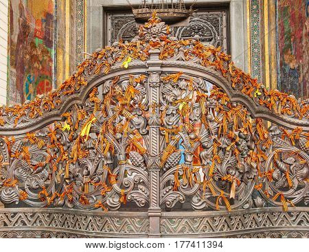 The ancient wrought-iron gates of Naval Cathedral in Kronstadt are decorated with St. George ribbons - symbol of Victory in Great Patriotic War.