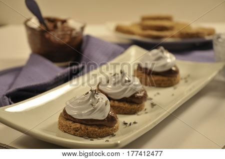 Beautifully plated S'mores dessert with chocolate ganache and lavender infused meringue