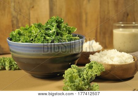 Healthy dish of creamy coconut kale with a side of steamed white rice in a serving bowl