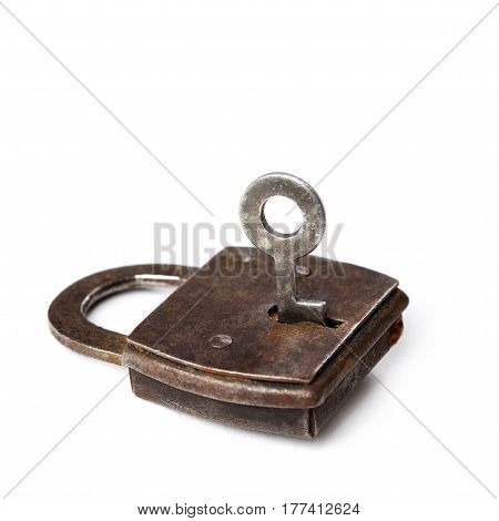 Vintage padlock with key on white background. Retro style private security object