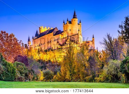 Segovia Spain. Autumn dusk view of Castle of Segovia known as Alcazar and built in 12th century in Castile and Leon