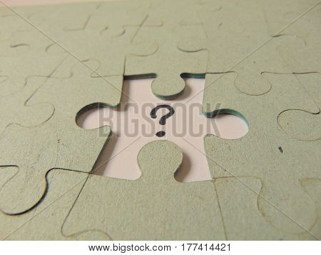 missing piece of a puzzle with question mark instead