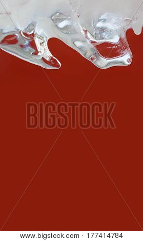 Beautiful frozen ice on red background. Abstract icy crystal object macro view. Xmas frame decorative element. shallow depth of field. Copy space photo.