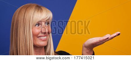 Happy Mature Women with copy space on her hand