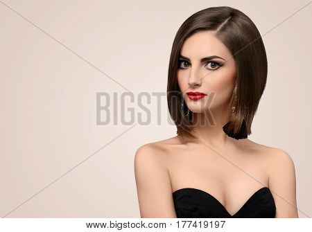 Young attractive fashion model with beautiful shiny healthy hair and flawless skin looking fiercely to the camera skincare hair care cosmetics cosmetology style luxury elegance grace.