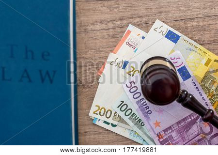 gavel and euros money on wooden table. close up.