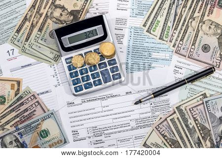 tax concept - form money calculator and pen.