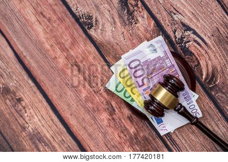 concept on corruption in justice. Judge gavel and euro money.