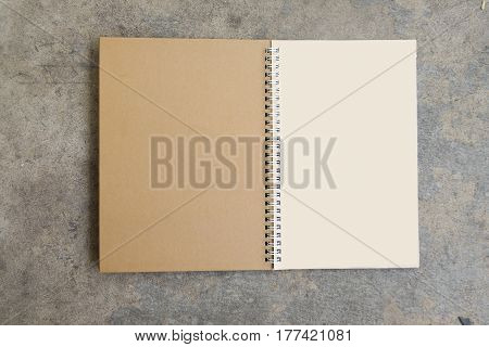 Blank brown calendar on a concrete background