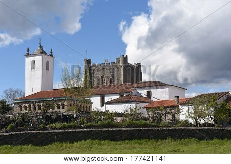 The Ancient Domus Municipalis of Braganca and Church of Santa Maria do Castelo and tower castle in the background. Braganca Braganca District Norte Region Portugal Europe