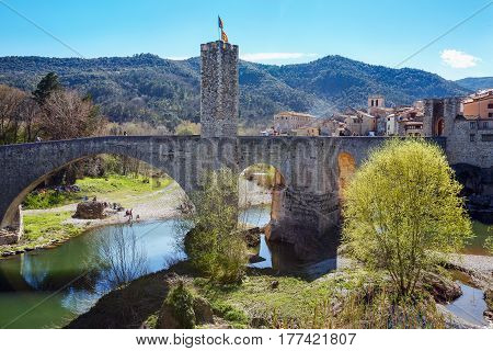 Old bridge over the river Fluvia in medieval town of Besalu, province Girona, Spain.