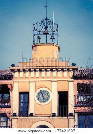 Clock tower with bells in Toledo Spain