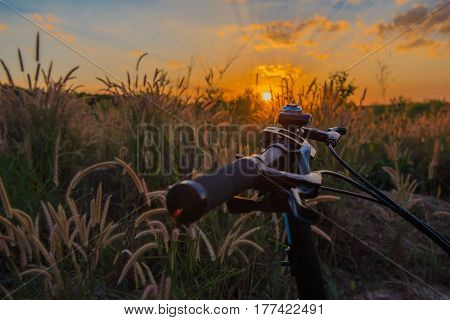 Closeup Bike in countryside sunset background .