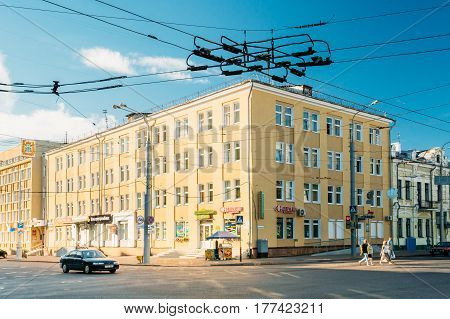 Gomel, Belarus - August 10, 2016: Soviet-era buildings painted in yellow on Lenin avenue street in sunny summer day in Gomel, Belarus
