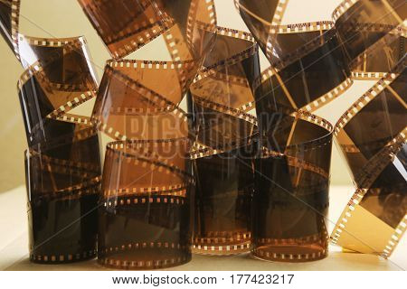 Photographic film rolls. Analog film strips top view.