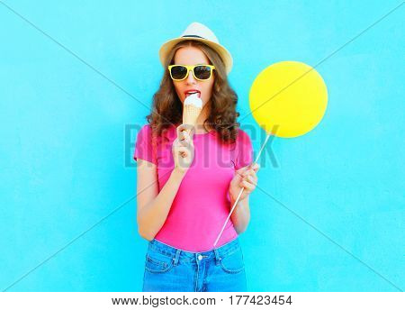 Fashion Woman Is Trying Ice Cream Wearing Straw Hat And Pink T-shirt Over Colorful Blue Background