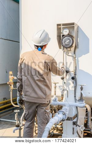 Technician fill with liquid nitrogen with Nitrogen storage tank at new factory