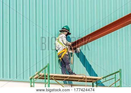 Technicians are welding steel structure. Construction site image for the background. Construction site low safety working condition